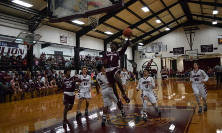 Sandies Open District Play with Road Win