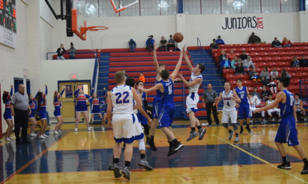 Second Half Surge Pushes Elks by Cougars